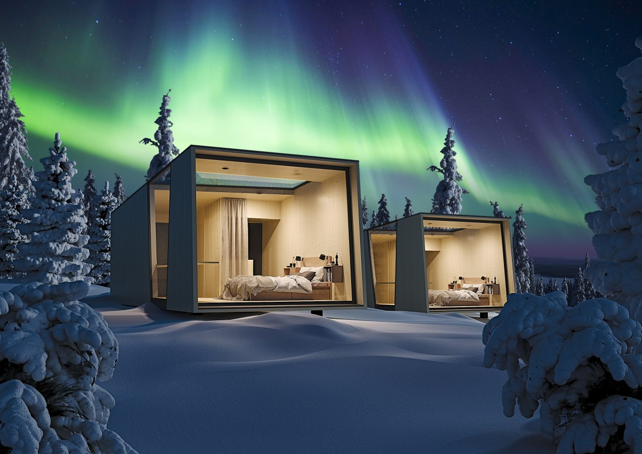 Accommodation in winter forest with northern lights in the background.