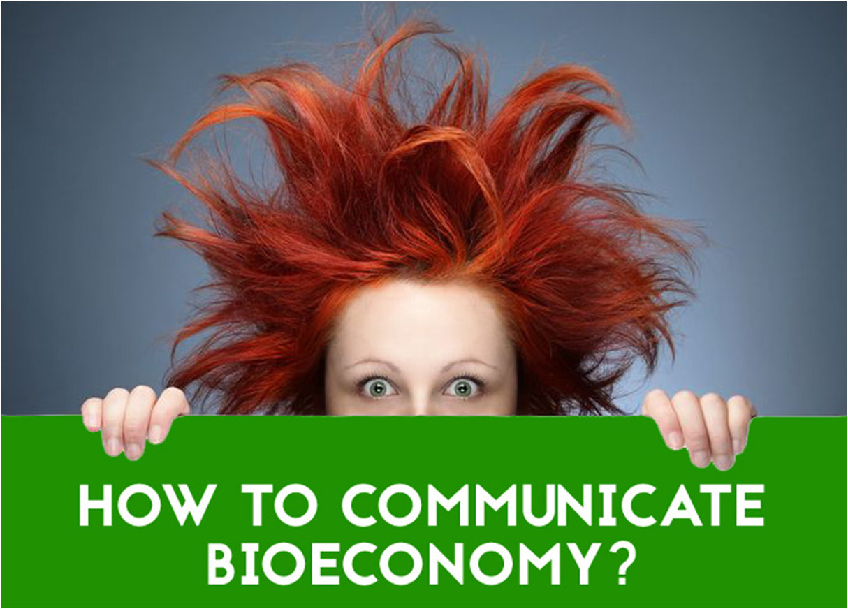 A woman with red hair holding a sign: How to communicate bioeconomy?
