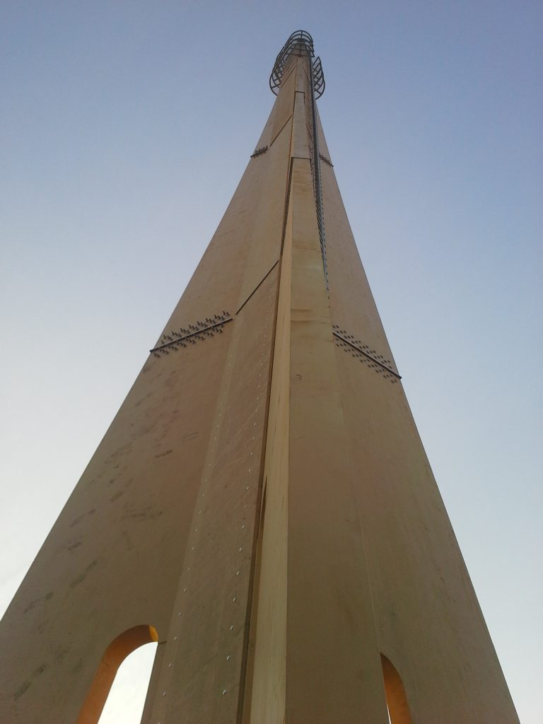 A wooden telecommunication mast.